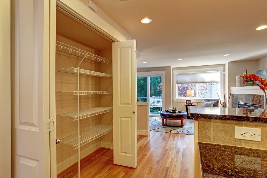 Kitchen room storage rack with folding doors