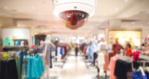 Cctv Security Camera Shopping Department Store On Background.