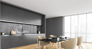 Black And White Minimalist Kitchen, Black Table And Beige Chairs Near Window With City View, Side Vi