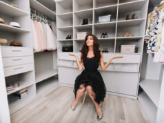 Young Brunette Woman Sitting In A Huge Dressing Room Thinks Over The Choice Of Clothes, She Is Dressed Stylish Black Outfit And Silver Shoes, Expressing True Positive Face Emotions